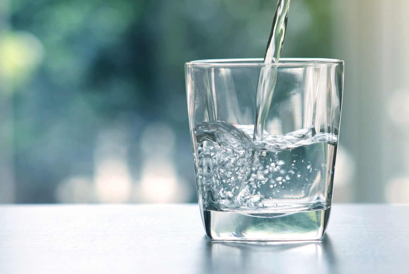 A glass of water Description automatically generated